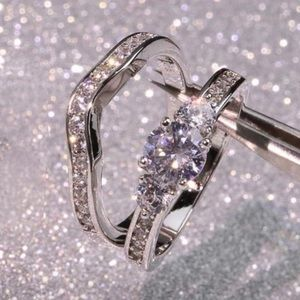 Jewelry - 2pc Sterling Silver Engagement Ring & Band Set